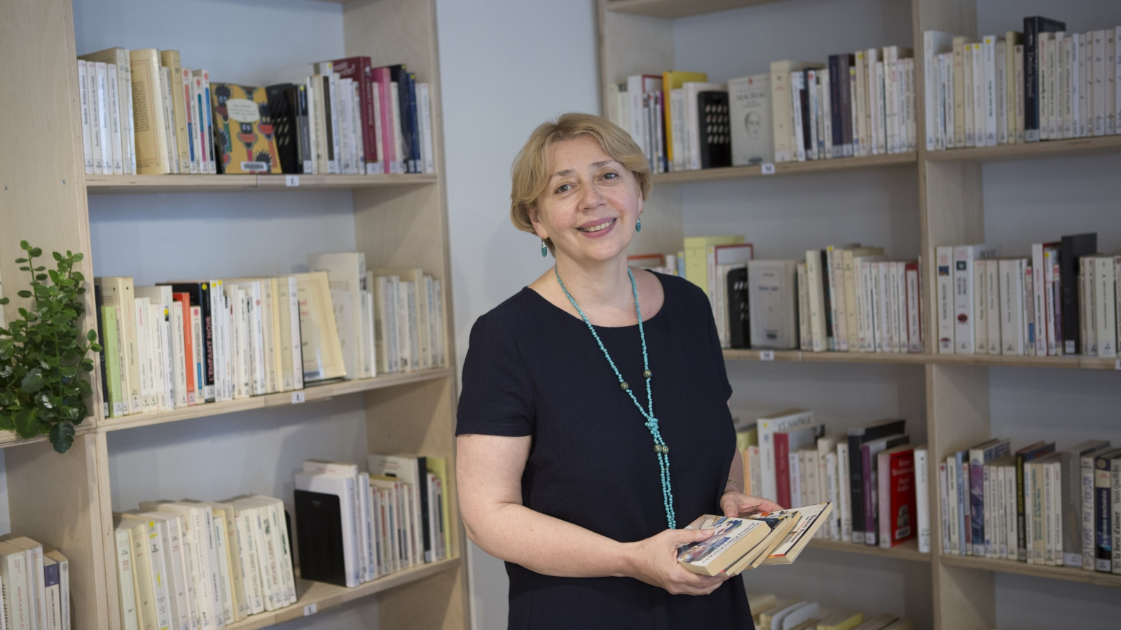 Director of Agora publishing house Marina Balavadze at the library in Tbilisi
