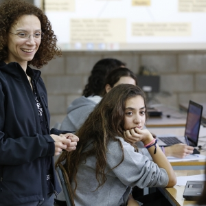 Lebanese teacher Lynn Sakr chats with students during a Media and Information Literacy (MIL) class at the school of Jesus and Mary in the Rabweh area, northeast of Beirut, Lebanon.