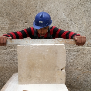 A young trainee stonemason at the vocational training center of the SDH association in Oran.