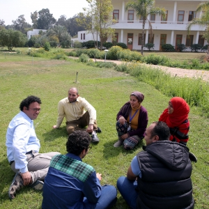 Egyptian facilitator Mohamed Abdel Mohsen ElMongy (L) speaks with Egyptian civil society actors at Sekem farm in Belbeis, Sharqia Governorate