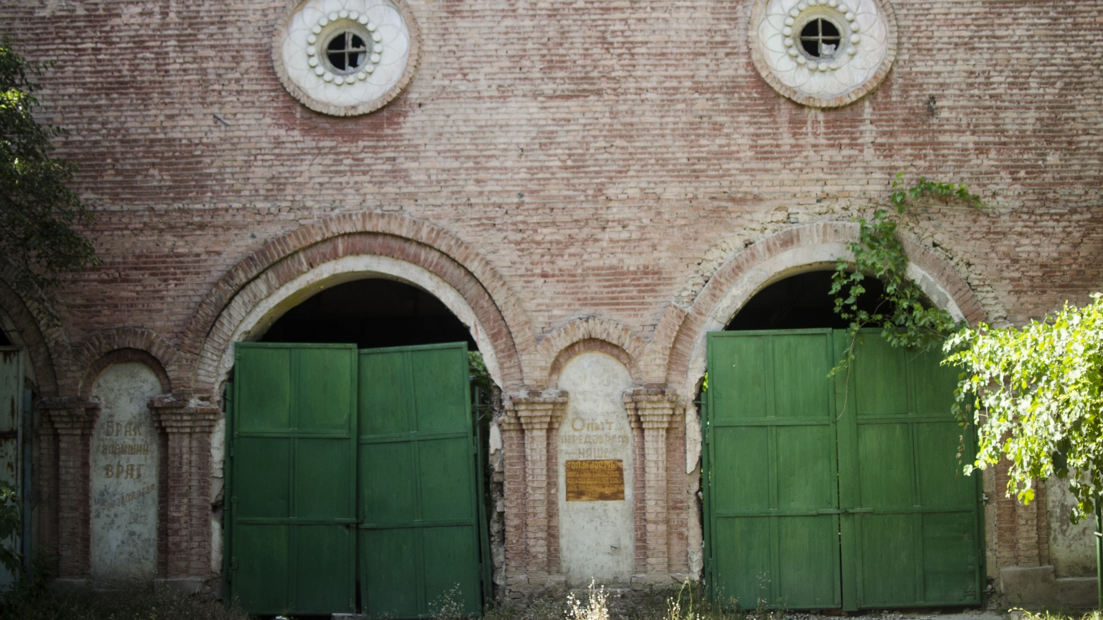 Façade of one of the workshops in Azot will remind you how old the factory is