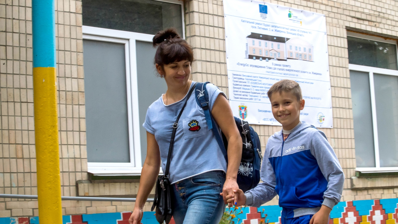 Svitlana Slyusar with her son Artem who is attending School No.3