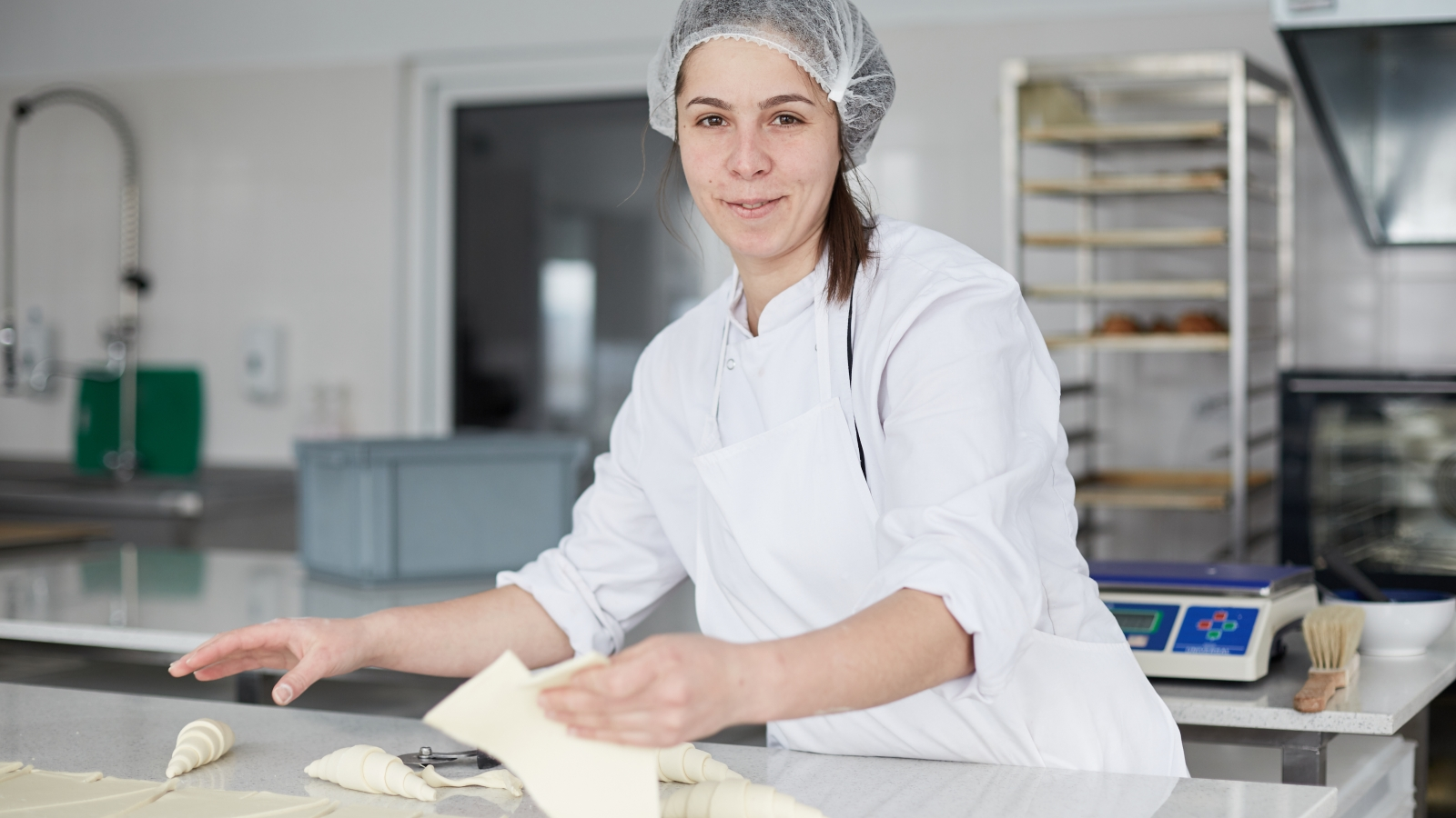 Women work at Diana's company that produces and sells a variety of croissants