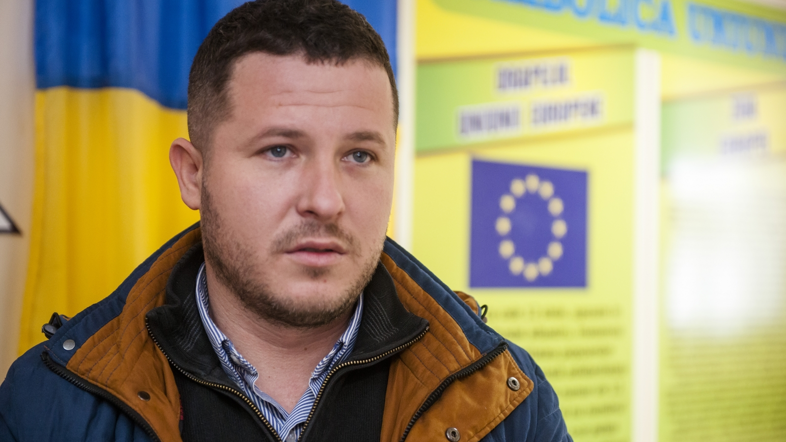 "Ion Gira, manager of ""Biocarbune"", a company supplying pellets to Cotul Morii school."