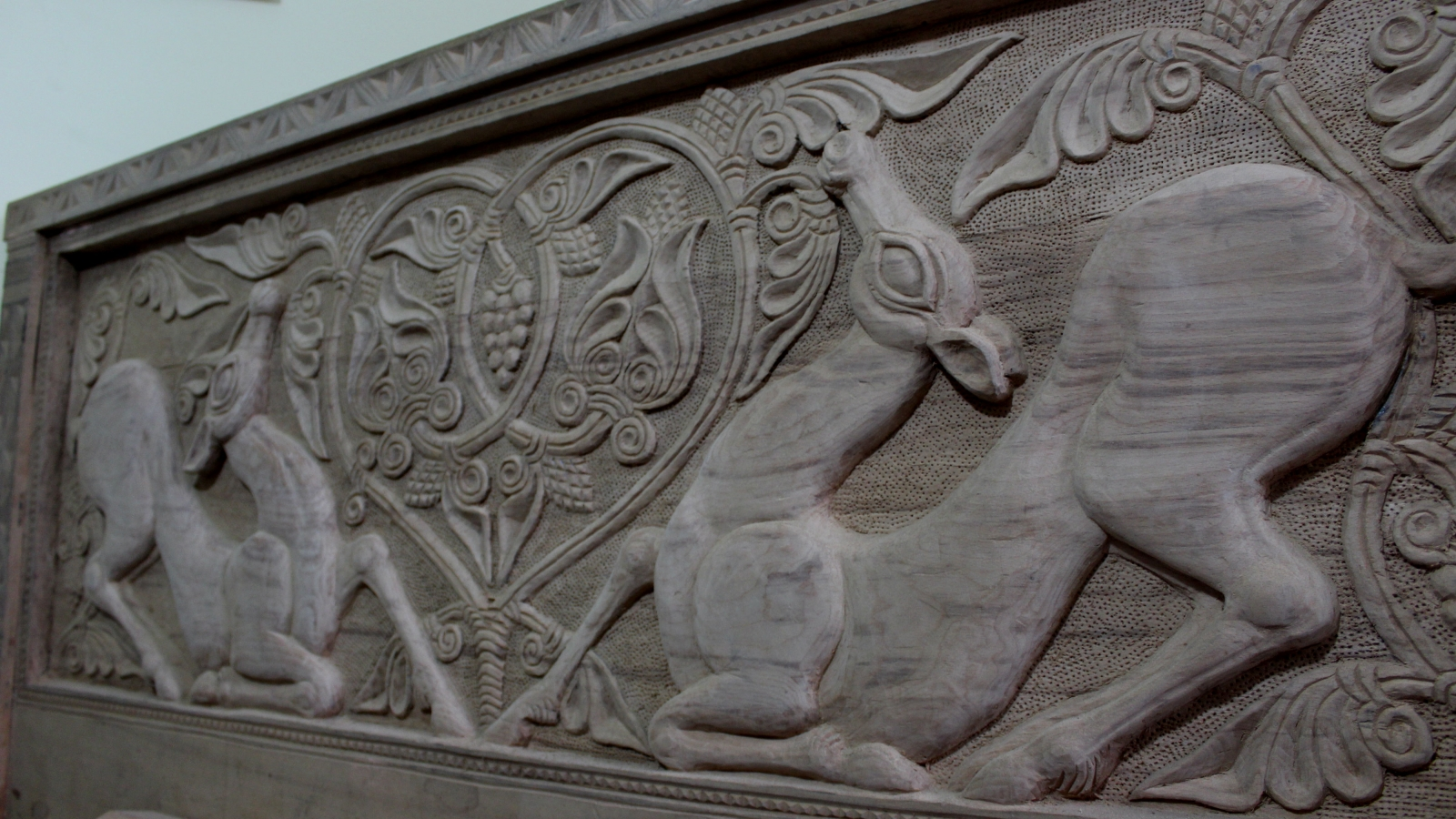 Capreolus depicted on the wooden headboard. Snoveli Art Studio, Village Sno, Kazbegi municipality