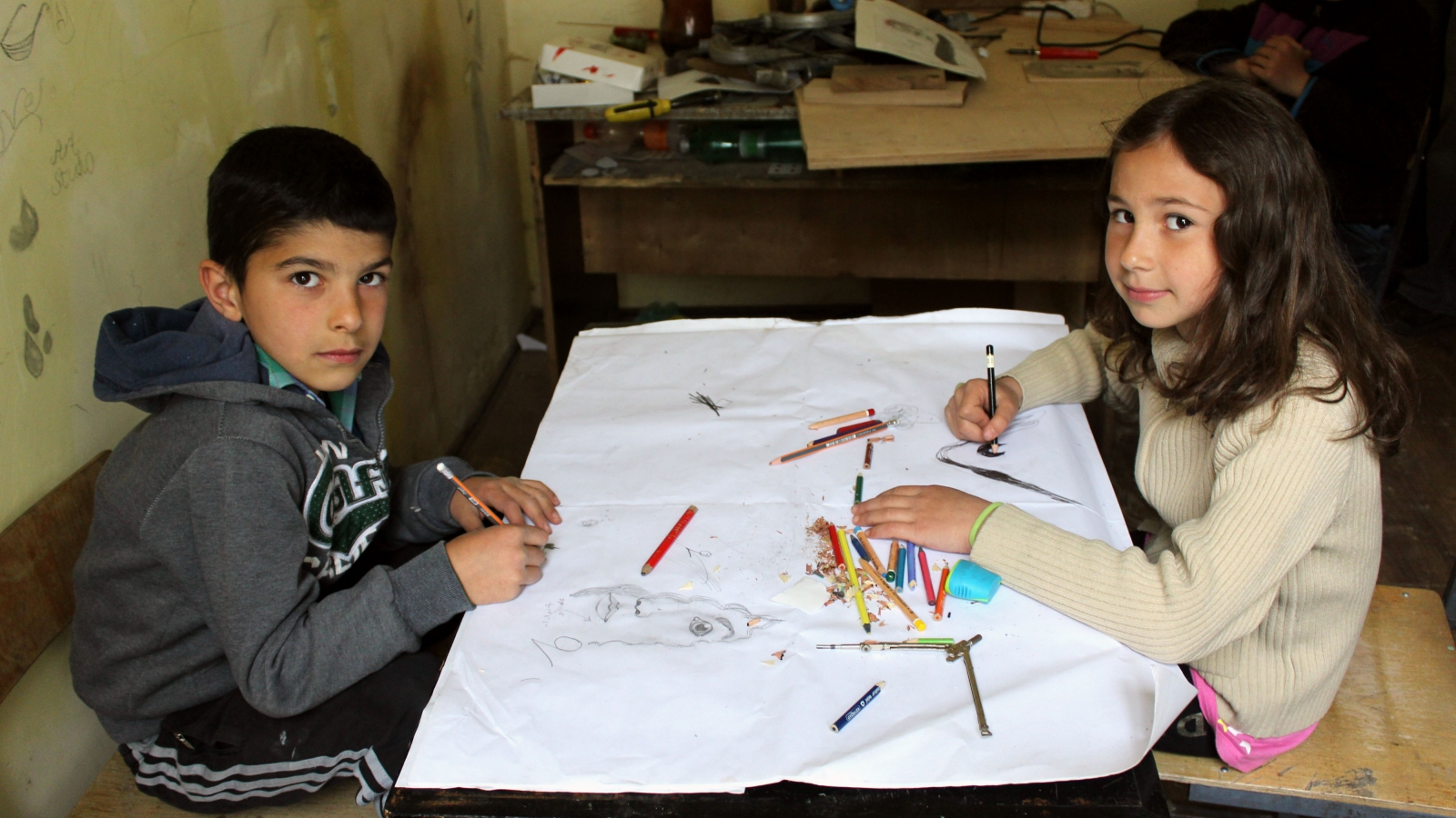 Saba Sabauri (left) and Ketevan Akiashvili (right) apprentices of Snoveli Art Studio