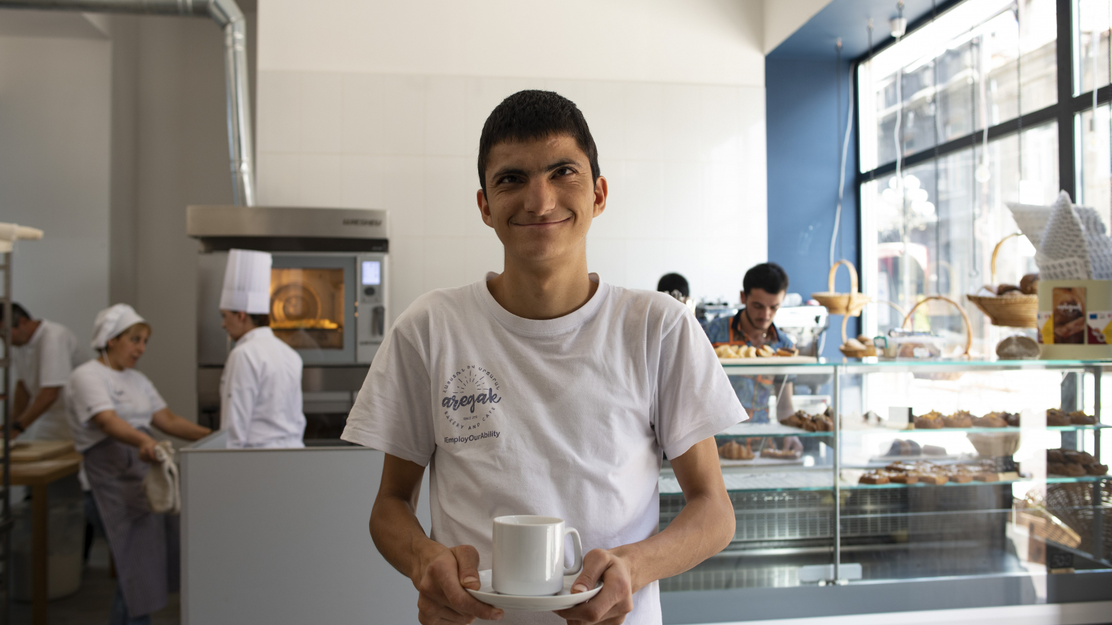 21-year-old Grisha Khachatryan works at the first inclusive bakery and café in Gyumri (Photo by Nazik Armenakian)