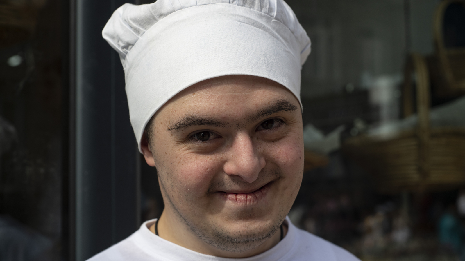Mikael Saakyan is 20 years old. He is an assistant to a baker at the inclusive bakery (Photo by Nazik Armenakian)