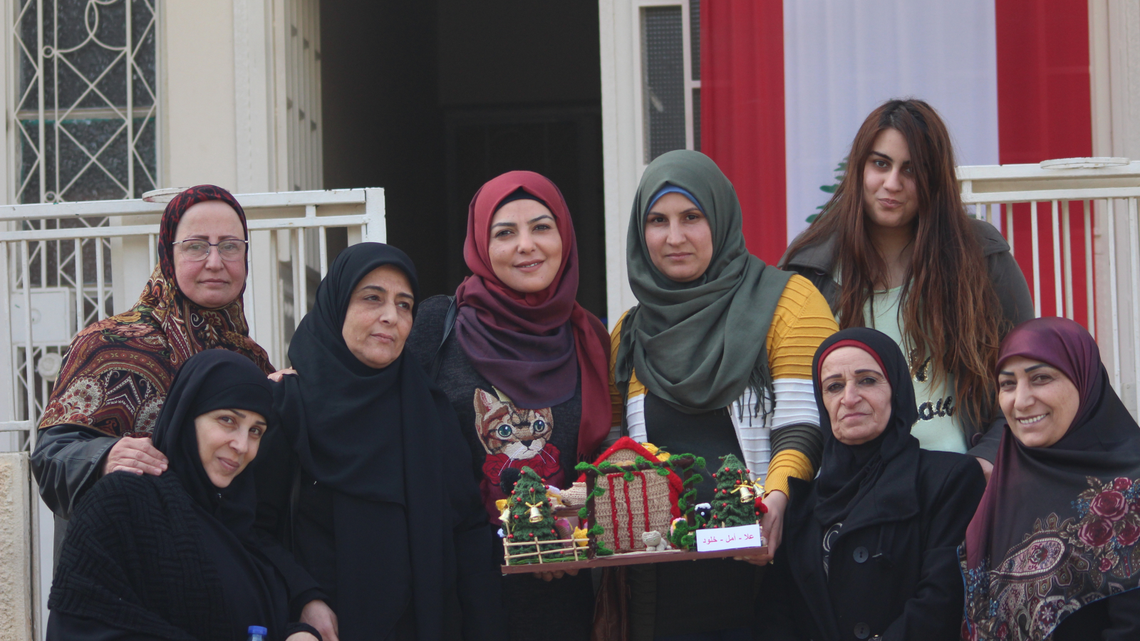 Souhayla and some of the participants of the EU-funded DAWRIC workshop pose with one of their creations in front of the municipality of Douris in Lebanon