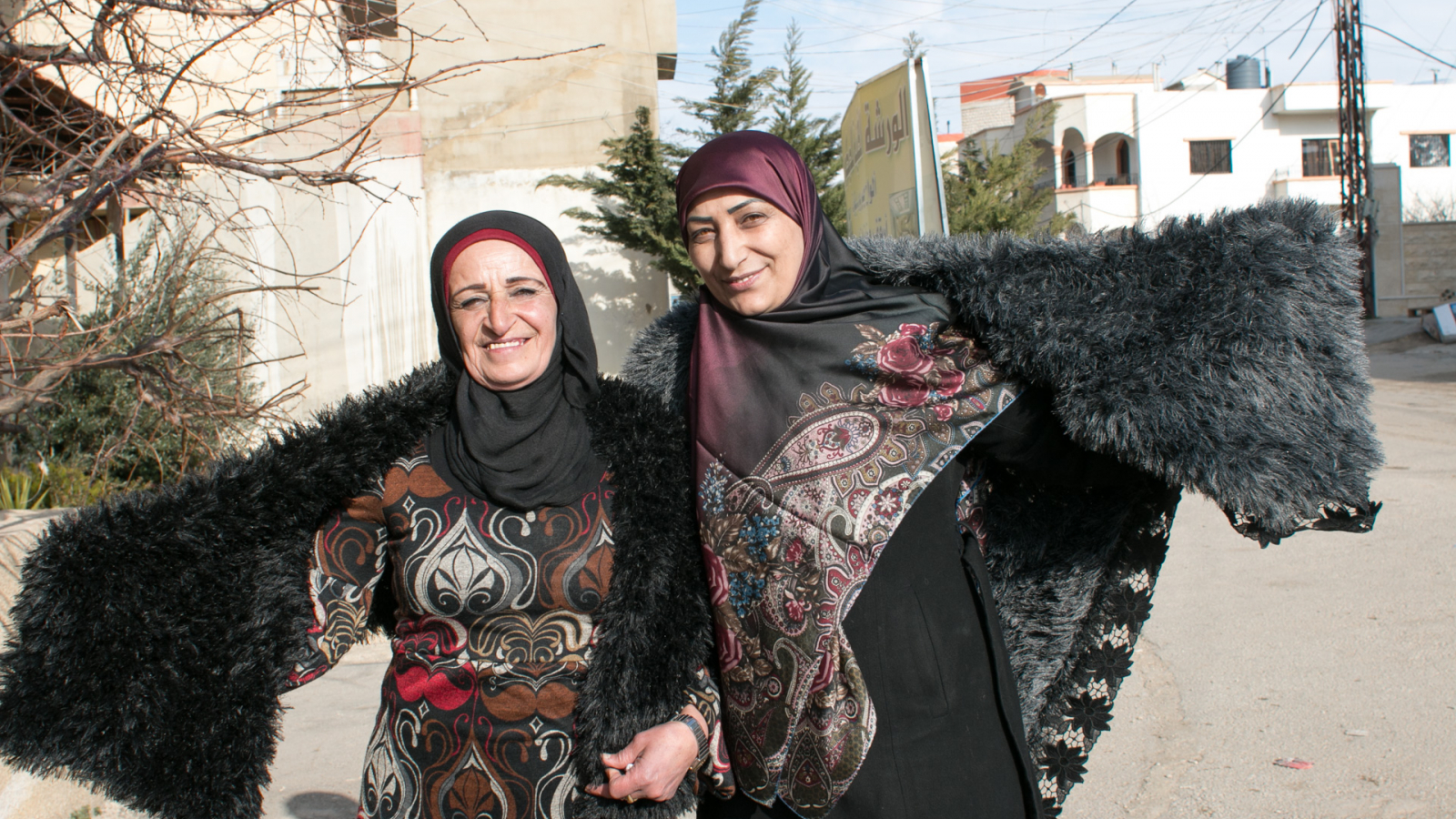 Souhayla and her neighbour both beneficiaries of the EU-funded Dawric project, pose with their creations