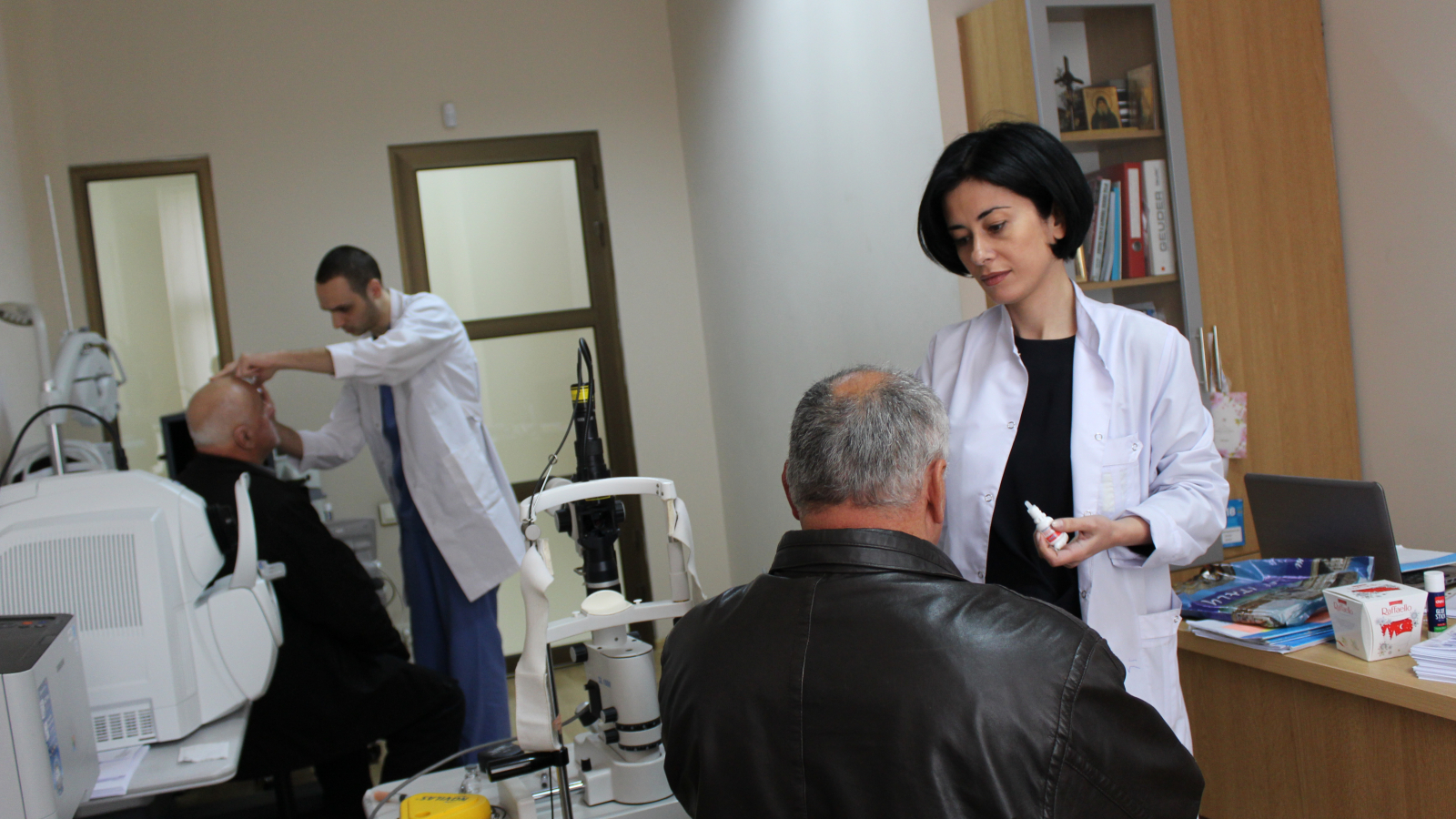 Tekla Mamageishvili, Director of a Tbilisi-based eye clinic, examines her patient
